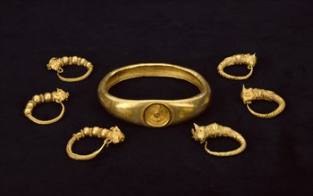 Gold earrings and gold armlet, fom a temple treasure, 4th-3rd century BC. Artist: Unknown.