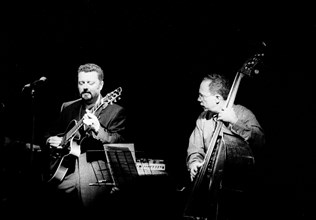 Eddie Gomez and Martin Taylor, Ronnie Scott's, London, July 2000. Artist: Brian O'Connor.
