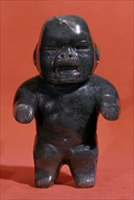 Jade figurine, probably a child although the Olmecs used to represent adults with childlike featu?