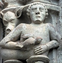 Detail of a capital showing a man with a pigeon in the hand, in the cloister of the Monastery of ?