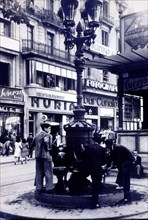 The fountain of Canaletas at the beginning of Las Ramblas, behind the iconic restaurants Canaleta?