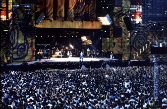 Overview of the audience and the stage during a concert of the Rolling Stones in Barcelona in 1990.