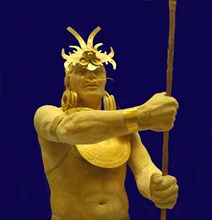 Torso of a warrior with helmet, chest, nose protection, earrings and gold bracelet.