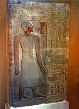 Stela of the Senouret, chief of the royal treasury, with his image and hieroglyphic writing, made?