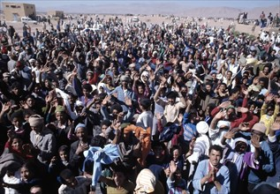 Green March, the Moroccan people led by their king go into the Sahara to protest for the self-det?