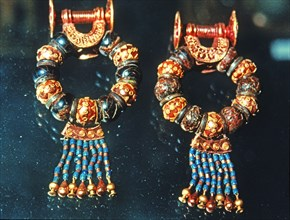 Gold earrings and jewels from the grave goods in Tutankhamun's tomb treasury.