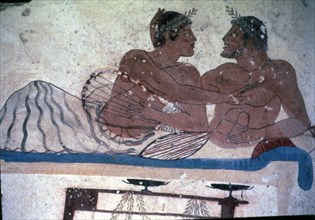 Fresco in the tomb of Tuffatore representing two men at a banquet.