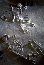Collective burial, necropolis Ponte San Pietro (Lazio), detail of two adult skeletons of a man an?