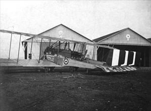 England. Caproni 600 biplane H 1918 next to the hangars.