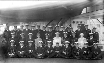King George V and Queen Mary with the crew of 'HMY Victoria and Albert', c1935.  Creator: Kirk & Sons of Cowes.