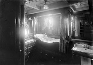 Interior of midships cabin on steam yacht 'Venetia', 1920. Creator: Kirk & Sons of Cowes.
