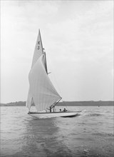 The 7 Metre 'Ancora' (K3) sailing under spinnaker, 1913. Creator: Kirk & Sons of Cowes.
