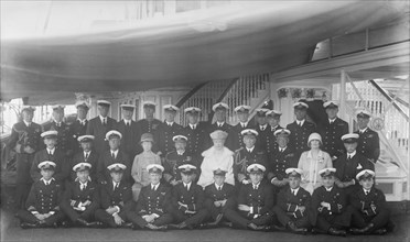 King George V, Queen Mary and crew on board 'HMY Victoria and Albert', 1927. Creator: Kirk & Sons of Cowes.