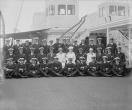 Queen Mary, King George V and crew on board 'HMY Victoria and Albert', 1925.  Creator: Kirk & Sons of Cowes.