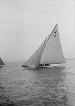 The 7 Metre 'Ancora' (K3) sailing close-hauled, 1913. Creator: Kirk & Sons of Cowes.