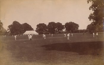 Cricket match, late 19th-early 20th century.
