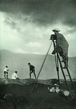 Photographing at the Crater's Lip, Aso-San', 1910.