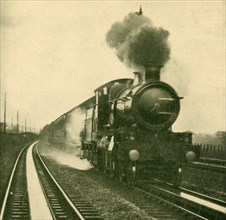 An Engine of the Star Class Picking Up Water at Speed, Goring, Great Western Railway', 1930.