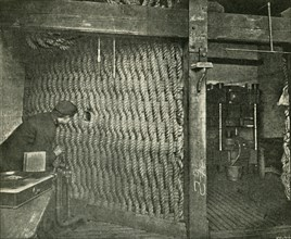 Rope Screen Used For Protection While Pressing Explosive Gun-Cotton', 1901.
