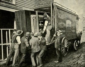 Loading The Camera On A Van For Removal', 1901.