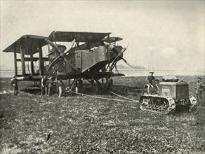 A Small Motor Tractor Getting a Huge R.A.F. Bombing Machine into Position...', (1919).