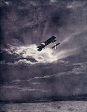 'British Airman Returning at Sunset After Successful Journey', 1917. Creator: Unknown.