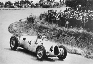 1936 Auto Union C type, Rosemeyer at German Grand Prix. Creator: Unknown.