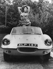 1959 Elva with posing female model. Creator: Unknown.