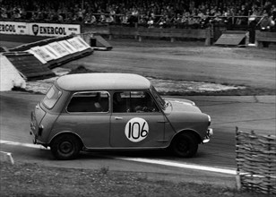 Morris Mini skidding at chicane, Goodwood 1961. Creator: Unknown.