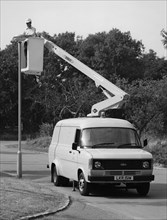 1981 Ford Transit 190 van with extending boom. Creator: Unknown.