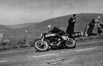 Norton, Geoff Duke, 1951 Isle of Man Tourist Tropy Race. Creator: Unknown.