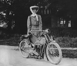 1909 Rex with motorcyclist Muriel Hind. Creator: Unknown.