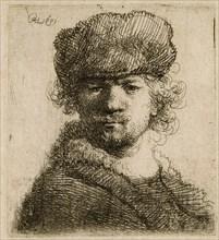 Self-portrait in a heavy fur cap: bust, 1631. Creator: Rembrandt Harmensz van Rijn.