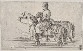 A valet taking two horses to bathe, sitting atop one horse in a river, the other besid..., ca. 1662. Creator: Stefano della Bella.