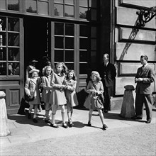 Princesses Birgitta, Margaretha and Desiree on their way from the Castle School, 24/5 1946. Creator: Unknown.