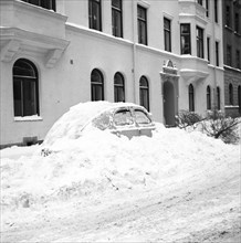 Snow in a car at telephone booth in Stockholm, Sweden, January 1954. Creator: Unknown.