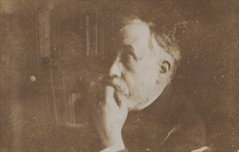 [Self-Portrait in Library (Hand to Chin)], probably 1895.