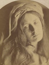Beatrice, 1866. The model (May Prinsep) has her hair loose with a turban at the top of her head. Cameron based the model?s pose, drapery and sad expression on a painting attributed to Guido Reni that ...