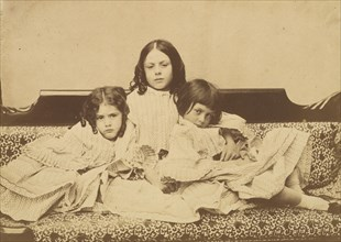 Edith, Ina and Alice Liddell on a Sofa, Summer 1858.