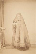 [La Comtesse in Hat with Veil and Cape with Fringe, Serie à la Ristori], 1860s.