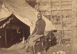 [Black Soldier in Camp], ca. 1863.