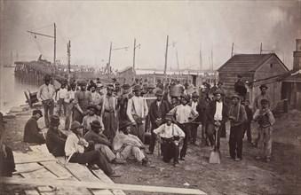Laborers at Quartermaster's Wharf, Alexandria, Virginia, 1863-65. Formerly attributed to Mathew B. Brady.