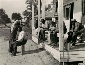 Haircutting in Front of General Store and Post Office on Marcella Plantation, Mileston, Mississippi, 1939.