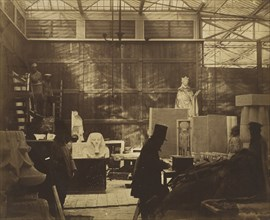 [Storeroom with Artisans and Plaster Casts, Crystal Palace], 1852.