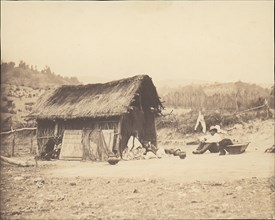 Family Seated by Thatched Hut, South America, 1850s.