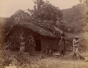 Thatched House, People in Foreground, Telegraph Lines in Background, 1860s-70s.
