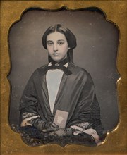 Young Woman Wearing Lace Gloves Holding a Daguerreotype Case, 1860s.