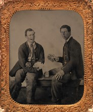 Union Soldiers Sitting on Bench, Playing Cards, 1861-65.