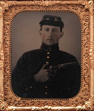 Union Soldier with Colt Revolver, in Studio, 1861-65.