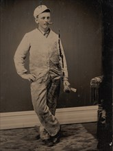 Painter, Smoking a Cigar, Holding a Brush and Scraper, 1870s-80s.